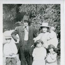 """Image of Print, Photographic - Copies: 1 (1 copy)  """"Cyforian [sic] Bellique ('Grandpa') with 'Babe' (Mary Leila) Carson and 'and 4 of my children)  about 1910   Edith Bellique Collection"""" (back of copy)"""