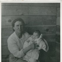 """Image of Print, Photographic - Copies: 1 (1 copy)  """"Charlotte Lulu Hinkle (Mrs. Bert DeLore) holding her grandchild Gerilee Harmell (aged 3 1/2 mos) Geri's sister, Mikell in r. hand corner at the Mill, Anatone, Mn[?]"""" (back0"""