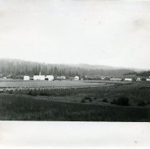 """Image of Print, Photographic - Copies: 2 (copies)  """"Grand Ronde Reservation headquarters with school and agency buildings, c. 1890"""" (paper attached to one copy)"""