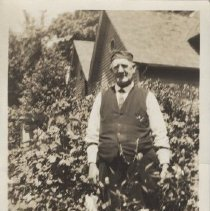 Image of Print, Photographic - Ross E. Moores standing in the yard of his home in Salem.