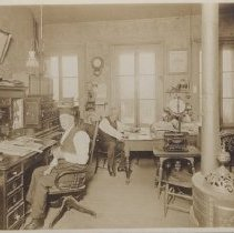 Image of Print, Photographic - State printing office in Salem; Ross E. Moores and L. R. Stinson at their desks.