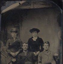 Image of Tintype - Tintype taken of Irene Stinson along with two young men and young woman. Irene Stands in the back wearing a black dress and hat.