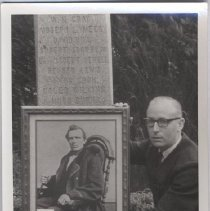 Image of Print, Photographic - Unidentified man holding portrait of Hugh Burns at Champoeg Monument