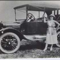 Image of Print, Photographic - Photograph of Zoe Goffin with a 1921 Ford Model T.