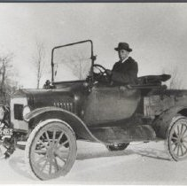 Image of Print, Photographic - Photograph of Zoe Goffin's brother in a 1917 Model T Ford.