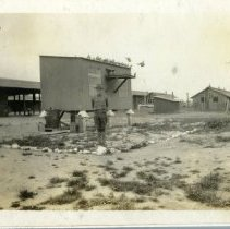 Image of Pigeon Coop with Percy Craig - Schoening Photograph Collection