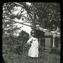 Image of Child in yard - Edward and Josephine Kemp Lantern Slide Collection