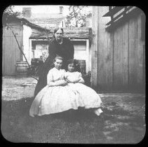 Image of Unidentified Woman with two young girls - Edward and Josephine Kemp Lantern Slide Collection
