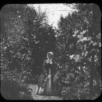 Image of Unidentified woman in garden - Edward and Josephine Kemp Lantern Slide Collection