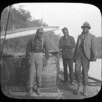 Image of Men loading barrels - Edward and Josephine Kemp Lantern Slide Collection