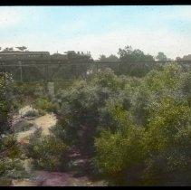 Image of Railroad bridge and train - Edward and Josephine Kemp Lantern Slide Collection