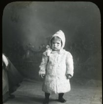 Image of Child in coat - All-Prayer Foundlings Home Lantern Slide Collection