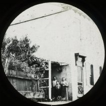 Image of Family on porch - All-Prayer Foundlings Home Lantern Slide Collection