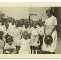 Image of Mary and school children - Lusby Family Photograph Collection