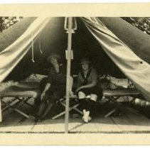 Image of Vee and Ethel sit under tent - Viola A. Tinker Glenn: Camp Chelan Photograph Collection