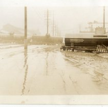 Image of Tank Cars across River Road - Turah Thurman Crull 1937 Flood Photograph Collection