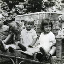 Image of 2008.108.05 - Gene Ferris and Friends on a Wicker Bench