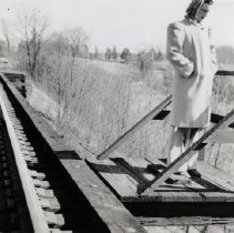 Image of 2008.143.02 - Lucy Stevens on Railroad Trestle over Rock Creek Railway