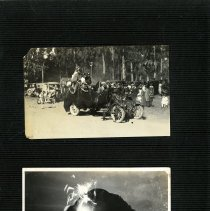 Image of Print, Photographic - Album page showing two B&W photos.  Top photo shows shows a vintage vehicle in a parade.  Lower photo shows fireworks in front of Morro Rock.