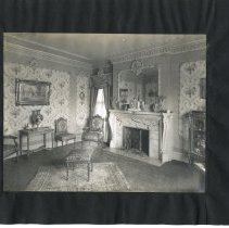 Image of Print, Photographic - Album page with a photo showing the inside of an elegant sitting room.  A fireplace with a large mirror above it can be seen in the center of photo.