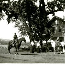 "Image of Print, Photographic - B&W panoramic photo showing people on horseback in front of the Headquarters House.   ""Morning ride to Pine Mountain"" ""Rose Mitchell - Mrs.E.G. Lewis"" written on back of photo."