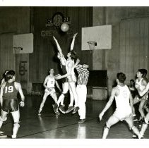 Image of Print, Photographic - B&W photo showing a young men playing basketball at Atascadero High School.