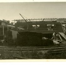 Image of Print, Photographic - B&W panoramic photo showing a large building under construction (Caladero Products Co.?).  Railroad tracks can be seen in the foreground.