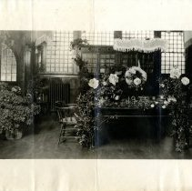 Image of Print, Photographic - B&W photo showing a table covered with roses.  The date 1925 can be seen on the table as well.
