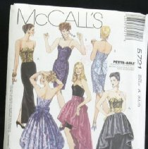 Image of Misses' strapless dress in two lengths, detachable skirt and cummerbund McCall's 5721, 15 pieces Close-fitting dress in two lengths has underlined and lined bodice with princess seams and boning, optional jeweled straps, waistline seams, back zipper closure; tapered skirt has front and back darts and back hemline slit; detachable lined skirt has waistband with hook and eye closure; bow and gathered cummerbund included. Size: miss A (6,8,10)