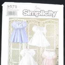 Image of Child's dress Simplicity 9579, 15 pieces Simplicity oliver goodin, classic heirloom sewing Dress gathered to back buttoned bodice has short gathered sleeves and back sash stitched to side seams. All dresses have eyelet trims and specialized sewing techniques for an heirloom sewing treatment. See sewing instructions. Size: child A