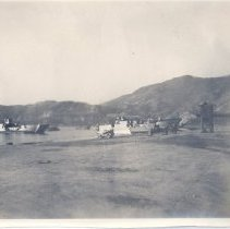 Image of 08.22.121 - Hiroshima Seaplane Base with DUKW's and larger ships moored off shore.