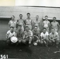 Image of 11.79.568 - TR-561  Military personnel in barracks area of Tinian. Back Row: George Koester, Leon Smith, Dick Padolsky, Morris Jeppson, Bruce Corrigan, Philip Barnes.  Front Row: Leo Raub, Roy Stradford, Richard Vertz, Carl Kasalek, L. Lawrence, William King.