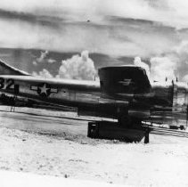 Image of 12.36.2 - Enola Gay with bomb bay doors open on the airfield on Tinian, Marianas Islands.