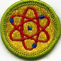 Image of 10.28.5 - Official Boy Scouts of America Atomic Energy Merit Badge.The patch is a circle, all embroidered, with light green and yellow, with a red atomic symbol employing blue electrons.  Created in 1963, the Boy Scouts of America approved this as the 104th in their series of Merit Badges.