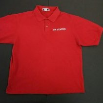 Image of 16.9.1 - National Atomic Museum polo shirt, red, size large. UP'N'ATOM text art work embroidered in white and black thread on left front.