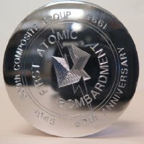 Image of 99.63.6 - An Ortiz engraved paperweight: 509th Composite Group First Atomic Bombardment 50th Anniversary 1945-1995.