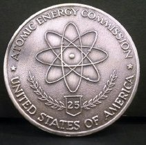 "Image of 13.27.19 - Printed on one side of the coin:  ""Atomic Energy Commission, 25, United States of America"" with Uranium symbol in center.
