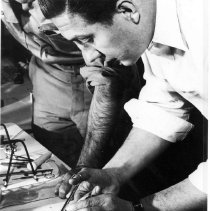 Image of Robert Huebner dissecting a mouse