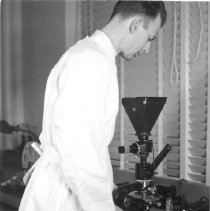 Image of Technician checking specimens to be photographed