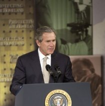 Image of NIH Campus Visits - George W. Bush speaking at the Natcher Building