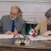 Image of NIH Directors - Ruth Kirschstein and Carlos Bazdresch signing US-Mexico Agreement.