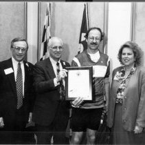 Image of NIH Directors - Dr. Harold E. Varmus receiving an award from Montgomery County