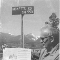 Image of Rocky Mountain Laboratory Photographs - Dr. William L. Jellison next to Ricketts Road