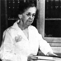 Image of Office of History Photograph Collection - Dr. Alice C. Evans in the laboratory