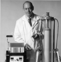Image of National Institute of Neurological Disorders and Stroke - Dr. Roscoe Brady demonstrating column chromatography