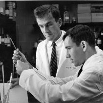 Image of National Institute of Arthritis and Musculoskeletal and Skin Diseases - Charles N. McEwen and medical student examining serum