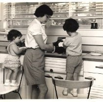Image of Jerry Hecht Digital Collection - Nina Starr Braunwald washing dishes with her two daughters