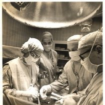 Image of Jerry Hecht Digital Collection - Drs. Nina Braunwald and Glenn Morrow operating on a patient