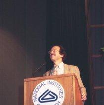 Image of NIH Directors - Director Harold Varmus speaking at podium