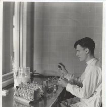Image of Science Service - E. A. Garlock in dustproof laboratory